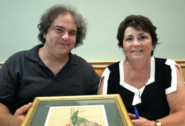 Peabody: Donato Mastrangelo, a proprietor from High Street Antiques of Ipswich and Johanne Cassia, an Ipswich-based folk artist, appraised heirlooms and antiques brought in by attendees. Photo by Mary Catherine Adams/Salem News.