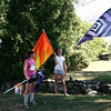 Danvers: Danvers Falcon Marching Band color guard Derek Bean, far left, Carly Branconnier, Ellen Gagnon and Kaitlin Harris give their flags one last wave after the end of practice on the last day of band camp. The band practiced at Essex Aggie High School in Danvers because of construction work being done at Danvers High School. Photo by Mary Catherine Adams/Salem News