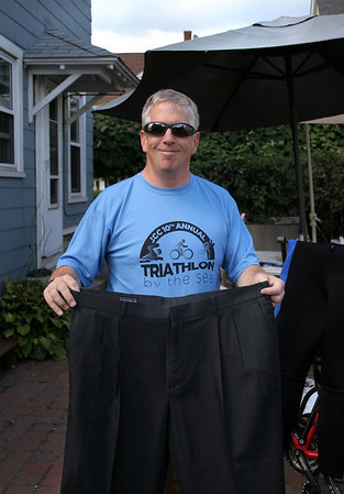 Beverly: Beverly City Councilor Jim Latter holds up a pair of pants he used to wear before he lost 60 pounds. He has cleared his closet of all his old clothes except for these pants, which he keeps as a reminder. Photo by Mary Catherine Adams/Salem News.