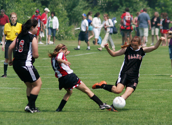 Katherine Towey, a Salem Witch, kicks the ball away from a North Andover Knight Hawk during the girls' U14 final match at the 19th annual Danvers Invitational Tournament on Memorial Day. Photo by Mary Catherine Adams/Salem News.<br /> , Katherine Towey, a Salem Witch, kicks the ball away from a North Andover Knight Hawk during the girls' U14 final match at the 19th annual Danvers Invitational Tournament on Memorial Day. Photo by Mary Catherine Adams/Salem News.