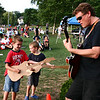 "Beverly: Bobby Ring, 7, at left, and his brother Thomas, 5, jam on their cardboard guitars along with ""All Together Now"" guitarist Bruce Hilton during the first weekend of the Beverly Homecoming festival in Lynch Park. Photo by Mary Catherine Adams/Salem News.<br /> , Beverly: Bobby Ring, 7, at left, and his brother Thomas, 5, jam on their cardboard guitars along with ""All Together Now"" guitarist Bruce Hilton during the first weekend of the Beverly Homecoming festival in Lynch Park. Photo by Mary Catherine Adams/Salem News."