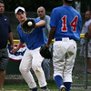 Salem: Danvers first baseman Corey Crossley catches the ball thrown to him by pitcher Mike Cravatis early in the Gallant Memorial Tournament final against Swampscott. Photo by Mary Catherine Adams/Salem News.<br /> , Salem: Danvers first baseman Corey Crossley catches the ball thrown to him by pitcher Mike Cravatis early in the Gallant Memorial Tournament final against Swampscott. Photo by Mary Catherine Adams/Salem News.