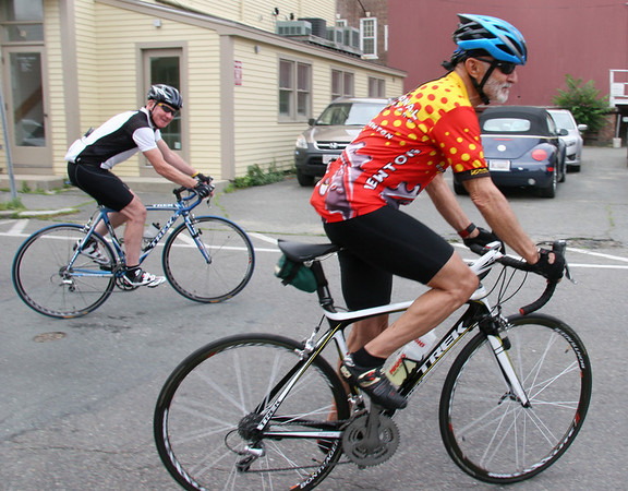 Jim Carney, left, and Ron Lappin head off to finish their bike ride after taking a break for lunch in Marblehead on Thursday. Photo by Mary Catherine Adams/Salem News.