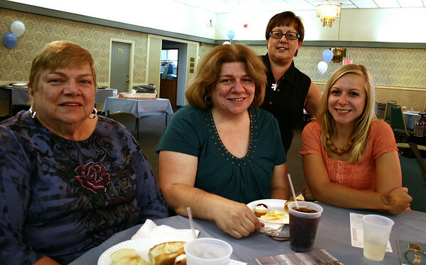Beverly: Charlotte Dean, left, Cheryl Fancy, Margaret Rubino, and Amanda Fancy enjoy sandwiches at the Lia Sophia jewelry fashion show held at the Franco American Club in Beverly. Part of the proceeds from the show will benefit the Hospice of the North Shore. Photo by Mary Catherine Adams/Salem News.
