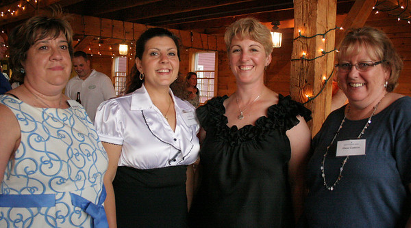 "Peabody: Mary Lou Dasilva, far left, Rosemary Frost, Karen Corning and Diane Gallucio stand in Smith Barn's doorway at Brooksby Farm. The Peabody Area Chamber of Commerce held an ""Antiques Roadshow"" event on Wednesday where attendees could bring a family heirloom or antique to be appraised. Photo by Mary Catherine Adams/Salem News."