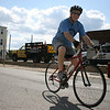 Beverly: Beverly City Councilor Jim Latter bikes down Beverly's Park Street in the late afternoon after getting home from work. Latter is currently training for a triathlon. Photo by Mary Catherine Adams/Salem News.<br /> , Beverly: Beverly City Councilor Jim Latter bikes down Beverly's Park Street in the late afternoon after getting home from work. Latter is currently training for a triathlon. Photo by Mary Catherine Adams/Salem News.