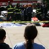 Salem: Students watch as firefighters extract a student from a car during a mock car crash at Salem High School. The mock crash was staged to discourage students from drinking and driving. Photo by Mary Catherine Adams/Salem News<br /> ?h, Salem: Students watch as firefighters extract a student from a car during a mock car crash at Salem High School. The mock crash was staged to discourage students from drinking and driving. Photo by Mary Catherine Adams/Salem News<br /> ?h