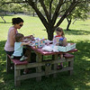 Megan Polcaro, left, and her children, Renzo, 2, and Chloe, 5, enjoy a picnic at Endicott Park in Danvers on Tuesday. Photo by Mary Catherine Adams/Salem News.