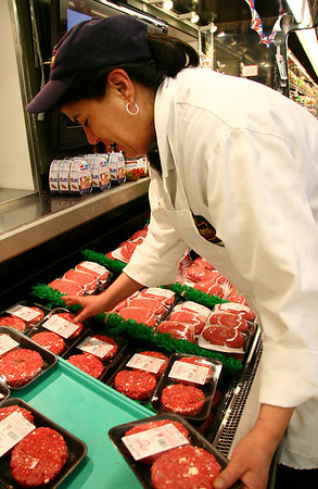 Danvers: Kathy Lervey, the meat manager at <br /> McKinnon's Market, puts gourmet hamburger patties on display. Photo by Mary Catherine Adams/Salem News.<br /> <br /> , Danvers: Kathy Lervey, the meat manager at <br /> McKinnon's Market, puts gourmet hamburger patties on display. Photo by Mary Catherine Adams/Salem News.
