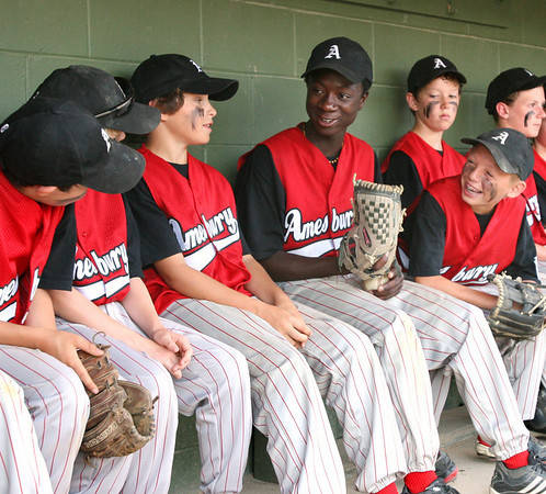 Peabody: Sulai Guilbault jokes around with his Amesbury teammates before the District 15 little league winner's bracket final. Photo by Mary Catherine Adams/Salem News.<br /> , Peabody: Sulai Guilbault jokes around with his Amesbury teammates before the District 15 little league winner's bracket final. Photo by Mary Catherine Adams/Salem News.