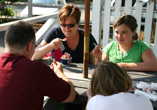 Heather Panico, left, and Elizabeth enjoy ice cream at the Cherry Farm Creamery on Conant Street in Danvers on Memorial Day. Photo by Mary Catherine Adams/Salem News.<br /> , Heather Panico, left, and Elizabeth enjoy ice cream at the Cherry Farm Creamery on Conant Street in Danvers on Memorial Day. Photo by Mary Catherine Adams/Salem News.