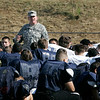 """Sgt. 1st class Joseph Toohey of the Army National Guard talks to a sea of Northshore football players, encouraging them to be """"student athletes"""" and not just football players. Student athletes, Toohey said before the start of practice, are winners whether or not they win on the field. Photo by Mary Catherine Adams/Salem News.<br /> , Sgt. 1st class Joseph Toohey of the Army National Guard talks to a sea of Northshore football players, encouraging them to be """"student athletes"""" and not just football players. Student athletes, Toohey said before the start of practice, are winners whether or not they win on the field. Photo by Mary Catherine Adams/Salem News."""