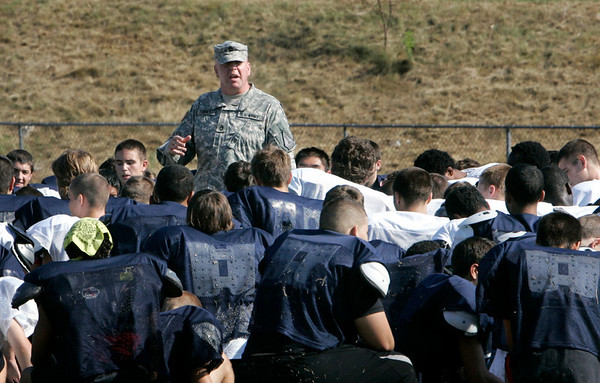 "Sgt. 1st class Joseph Toohey of the Army National Guard talks to a sea of Northshore football players, encouraging them to be ""student athletes"" and not just football players. Student athletes, Toohey said before the start of practice, are winners whether or not they win on the field. Photo by Mary Catherine Adams/Salem News.<br /> , Sgt. 1st class Joseph Toohey of the Army National Guard talks to a sea of Northshore football players, encouraging them to be ""student athletes"" and not just football players. Student athletes, Toohey said before the start of practice, are winners whether or not they win on the field. Photo by Mary Catherine Adams/Salem News."