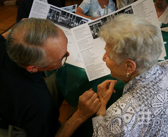 Jim Tedford, Jr., left, and Adeline Diehl sing songs whose lyrics are printed on their placemats at the Ipswich Rotary club's annual lunch for senior citizens. Photo by Mary Catherine Adams/Salem News.   <br /> /|+, Jim Tedford, Jr., left, and Adeline Diehl sing songs whose lyrics are printed on their placemats at the Ipswich Rotary club's annual lunch for senior citizens. Photo by Mary Catherine Adams/Salem News.   <br /> /|+