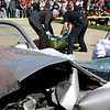 Salem: Students took part in a mock car crash discouraging drinking and driving at Salem High School. Here, police and funeral home workers remove a body bag from the car crash scene. Photo by Mary Catherine Adams/Salem News