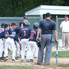 Beverly: Josh Freedman prepares to jump into the arms of his teammates after hitting a home run with the bases loaded in the third inning. Freedman's hit put Peabody West into the lead, 6-9, after the team trailed Amesbury in the first two innings. Photo by Mary Catherine Adams/Salem News.<br /> , Beverly: Josh Freedman prepares to jump into the arms of his teammates after hitting a home run with the bases loaded in the third inning. Freedman's hit put Peabody West into the lead, 6-9, after the team trailed Amesbury in the first two innings. Photo by Mary Catherine Adams/Salem News.