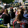 Salem: Salem High School students watch firefighters tending to a victim during a mock car crash staged to discourage students from drinking and driving. Photo by Mary Catherine Adams/Salem News