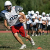 Jason Budde, a Peabody High School junior, practices running with the football during the third day of the NFL High School Player Development Program at Beverly High School. Photo by Mary Catherine Adams/Salem News.<br /> , Jason Budde, a Peabody High School junior, practices running with the football during the third day of the NFL High School Player Development Program at Beverly High School. Photo by Mary Catherine Adams/Salem News.<br />