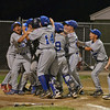 Danvers American Williamsport Team 2012<br /> greet team mate Shane Smith at home after his 2 run HR to give the the District 15 Chamionship.