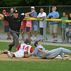 Danvers American Williamsport Team 2012<br /> Danvers vs Gloucester Championship game.<br /> First baseman Joe Nicolo trys to get the call at first.
