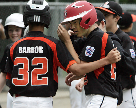 Beverly:<br /> Beverly's Joey Ward, right, is congratulated by Ryan Barror and his fellow players when he comes in after hitting a home run early in the game during the Boxford at Beverly Little League game at Harry Ball Field.<br /> Photo by Ken Yuszkus / Salem News, Tuesday, July 2, 2013.