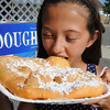 Danvers:<br /> Taylor Brett, 11, of Danvers, prepares to bite into some fried dough at the Fourth of July festivities at Plains Park.<br /> Photo by Ken Yuszkus / Salem News, Wednesday, July 3, 2013.