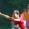 Beverly: Artworks at Waring camper Ethan Scott, 7, laughs while he runs through sprinklers while playing capture the flag on a hot Friday afternoon. David Le/Salem News