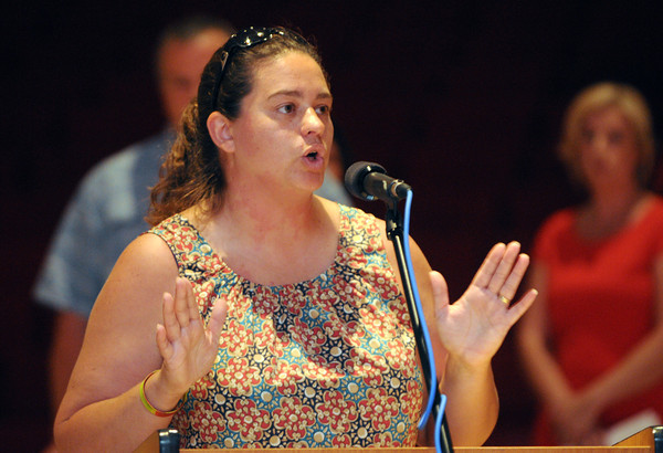 Salem:<br /> Pam Ryan speaks at the podium during the School Committee meeting. The School Committee was scheduled to vote on whether to kill the extended school year at Saltonstall School.<br /> Photo by Ken Yuszkus / Salem News, Monday, July 15, 2013.