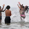 Beverly:<br /> From left, Tayzha Coulton of Boston splashes, while Jan Luis Pena Ortis of Beverly watches Ireonna Scott and Kristina Hall, both of Beverly, get soaked while in the ocean at Independence Park<br /> Photo by Ken Yuszkus / Salem News, Tuesday, July 2, 2013.