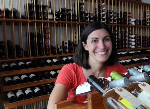 Swampscott:<br /> Michelle Penney is the owner of Sea Glass Wine and Beer in Swampscott.<br /> Photo by Ken Yuszkus / Salem News, Monday, July 8, 2013.