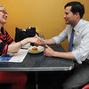Beverly:<br /> Renya Onasick of Marblehead, left, shakes hands after speaking with Seth Moulton at the Atomic Cafe. Seth Moulton, the 34 year-old Marblehead native and Iraq War veteran who plans to run against incumbent Congressman John Tierney, was in the North Shore to meet people and kick off his campaign.<br /> Photo by Ken Yuszkus / Salem News, Tuesday, July 9, 2013.