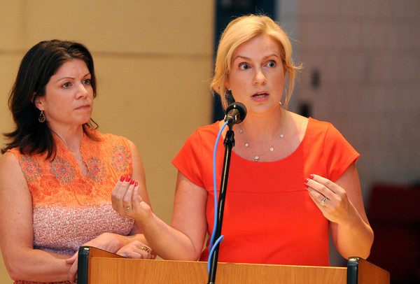 Salem:<br /> Former president of the Salem Education Foundation Sarah Morrill, left, and president Janine Matho both speak at the podium during the School Committee meeting. The School Committee was scheduled to vote on whether to kill the extended school year at Saltonstall School.<br /> Photo by Ken Yuszkus / Salem News, Monday, July 15, 2013.