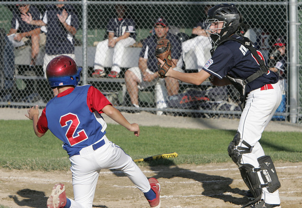 Lynn:<br /> Peabody's catcher Chris Kwmuntis gets the ball to get Lynn's Jesse Anderson out at home during the Peabody West Little League all-star team vs. East Lynn in District 16 baseball game.<br /> Photo by Ken Yuszkus / Salem News, Friday, July 5, 2013.