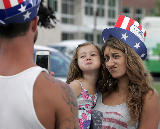 Danvers:<br /> Derek Landry takes a photo of Teagan, 4, and Marissa, of Danvers, as they make funny expressions with their patriotic attire at Plains Park during the Fourth of July festivities.<br /> Photo by Ken Yuszkus / Salem News, Wednesday, July 3, 2013.