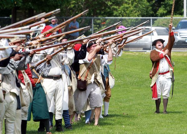 Marblehead: Larry Sands, of Marblehead's Glover's Regiment, orders a round of musket fire at the conclusion of a re-enactment on Saturday afternoon at Seaside Park. David Le/Salem News
