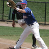 Lynn:<br /> North Shore Navigators' first baseman John Hennessey gets the throw as Martha's Vineyard Sharks' Tad Gold, of Endictt College, safely gets back to first during the North Shore Navigators game vs. Martha's Vineyard Sharks at Fraser Field.<br /> Photo by Ken Yuszkus / Salem News, Wednesday, July 3, 2013.