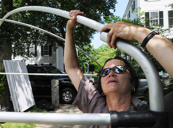Marblehead:<br /> Linda Mahoney sets up her canopy outside Abbot Hall Friday to enable her to sell her colored woodblock prints on Saturday at the Marblehead Festival of Arts.<br /> Photo by Ken Yuszkus / Salem News, Friday, July 5, 2013.