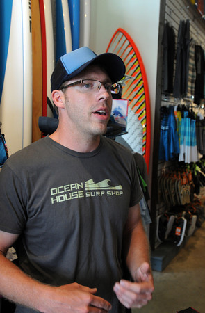 Swampscott:<br /> Tim Oviatt is the owner of Ocean House Surf Shop in Swampscott.<br /> Photo by Ken Yuszkus / Salem News, Monday, July 8, 2013.
