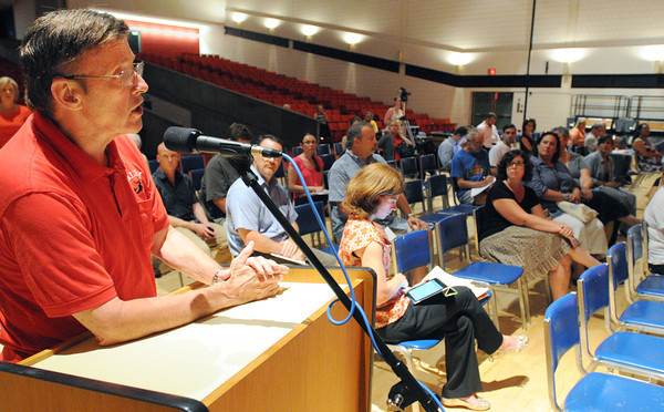 Salem:<br /> Council at large Tom Furey speaks at the podium during the School Committee meeting. The School Committee was scheduled to vote on whether to kill the extended school year at Saltonstall School.<br /> Photo by Ken Yuszkus / Salem News, Monday, July 15, 2013.