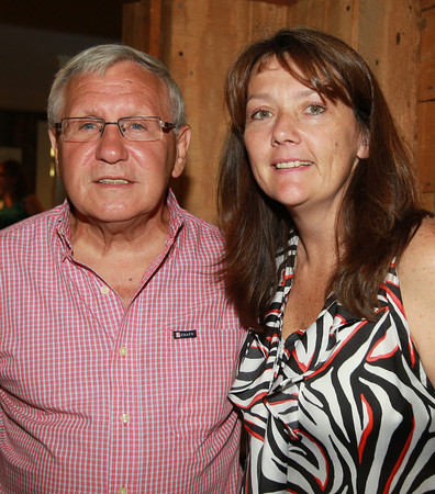 Peabody: Former Peabody Mayor Mike Bonfanti, and Tammy Messina, of the Peabody Historical Society, at the Peabody Area Chamber of Commerce's summer networking event held at Smith Barn at Broooksby Farm on Wednesday evening. David Le/Salem News