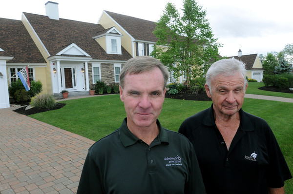 Topsfield:<br /> Alan Berry, left, vice president and Carl Berry, president, stand outside a model home at their English Commons in Topsfield.<br /> Photo by Ken Yuszkus / Salem News, Tuesday, July 2, 2013.