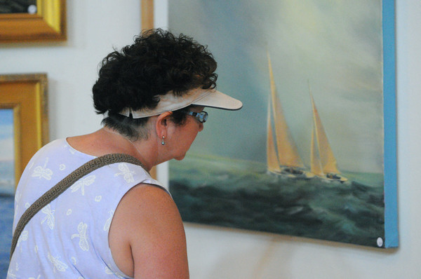 Marblehead:<br /> Katy Fickenwirth of Beverly takes a closer look at one of the paintings inside Abbot Hall during the Marblehead Festival of Arts.<br /> Photo by Ken Yuszkus / Salem News, Friday, July 5, 2013.