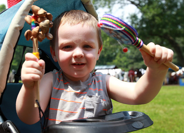 Danvers: Nathaniel LeGendre, 2, of Lawrence plays with some noise makers during a Native American Pow Wow at Endicott Park in Danvers on Saturday afternoon. David Le/Salem News