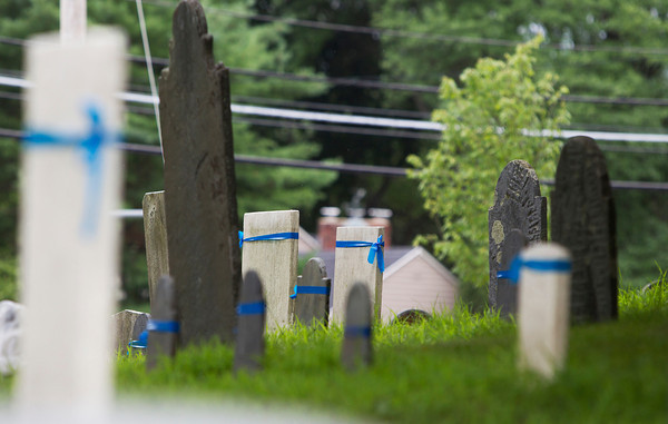 Wenham: There is an ongoing project to restore many of the gravestones in _______ Cemetery in Wenham, repairing some broken and falling over tombstones. David Le/Salem News