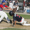 Lynn:<br /> Peabody's Nick Iannuzzi is safe at home as Lynn's pitcher Jesse Anderson waits for a throw from the catcher who let the ball get past him during the Peabody West Little League all-star team vs. East Lynn in District 16 baseball game.<br /> Photo by Ken Yuszkus / Salem News, Friday, July 5, 2013.