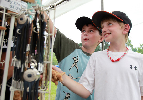 Danvers: 9-year-olds William Johnstone, left, and Ben Shea, of Beverly, look at necklaces and pendants at a Native American Pow Wow at Endicott Park in Danvers on Saturday afternoon. David Le/Salem News