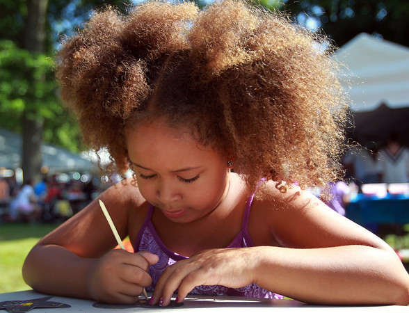 Ipswich: Sophia Cestaro, 6, visiting from Phoenix, AZ, works intently on a scratch art butterfly at the annual Greek Festival on Saturday afternoon at the Hellenic Center in Ipswich. David Le/Salem News