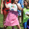 "Beverly:<br /> Grace Marino who is dressed as Strawberry Shortcake throws the ball during the Star Wars game which is a form of dodge ball. She was participating in the Beverly Recreation Department Parks Program at Lynch Park. ""Movie stars"" was the theme for the games. 13 parks and 4 camps participated.<br /> Photo by Ken Yuszkus / Salem News, Thursday, July 18, 2013."