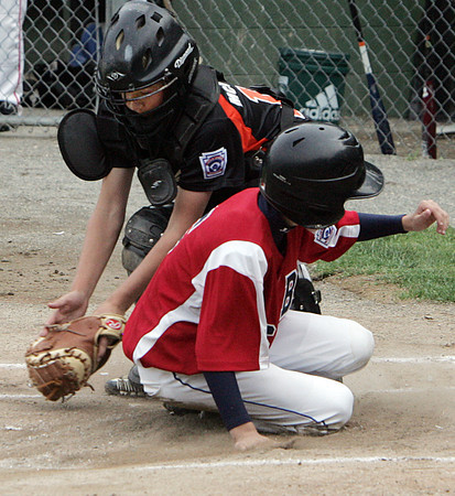Beverly:<br /> Boxford's William Robert slides and is safe at home as Beverly's catcher Timmy McCarthy grabs the throw during the Boxford at Beverly Little League game at Harry Ball Field.<br /> Photo by Ken Yuszkus / Salem News, Tuesday, July 2, 2013.