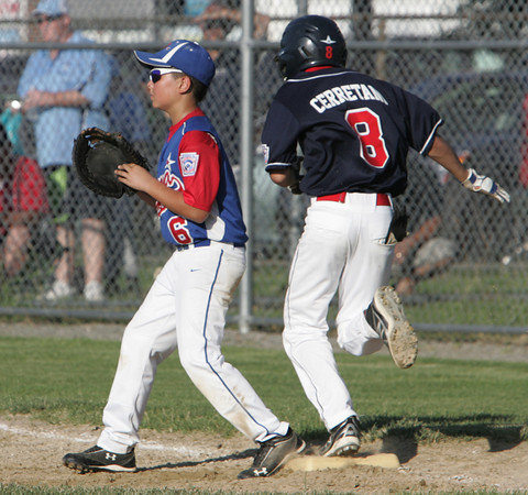 Lynn:<br /> Peabody's John Cerrantani tags first base as Lynn's Spencer Divirgilio waits for the throw during the Peabody West Little League all-star team vs. East Lynn in District 16 baseball game.<br /> Photo by Ken Yuszkus / Salem News, Friday, July 5, 2013.